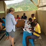 Suzanne Demarco explains a painting method to a group of students in Jacmel, Haiti where she volunteered for one  week.