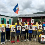 A group of Haitian students taught by former Malibu art teacher Suzanne Demarco, pose with the portraits she helped them create.